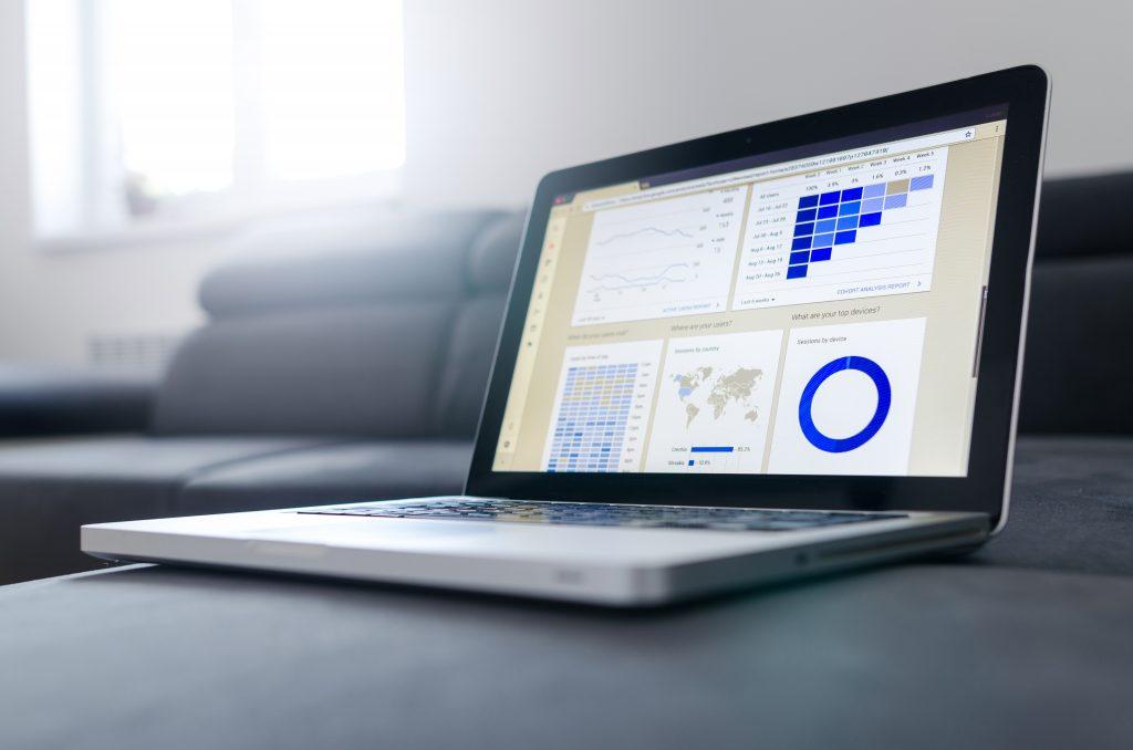 Laptop showing hcm software payroll data