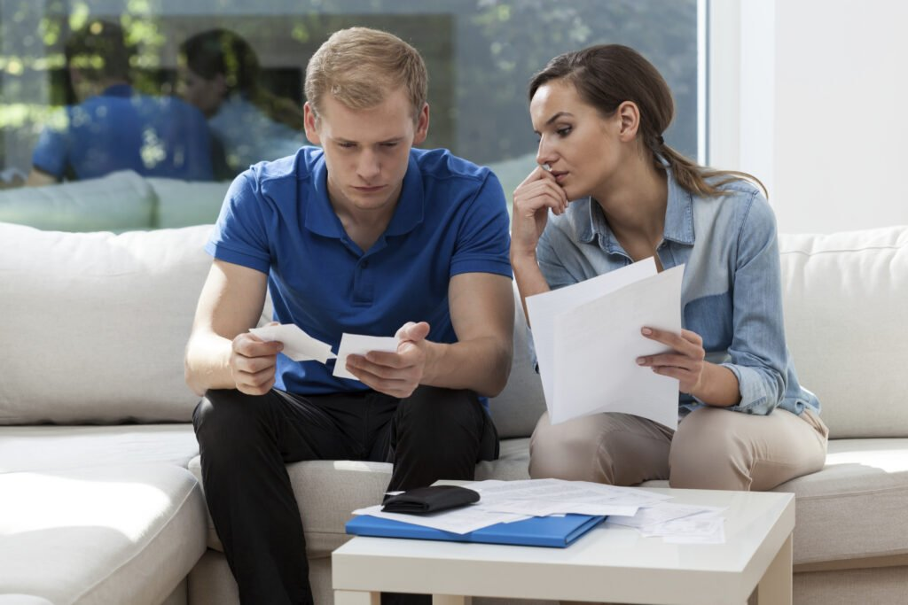 Two people analyzing finances for year-end planning