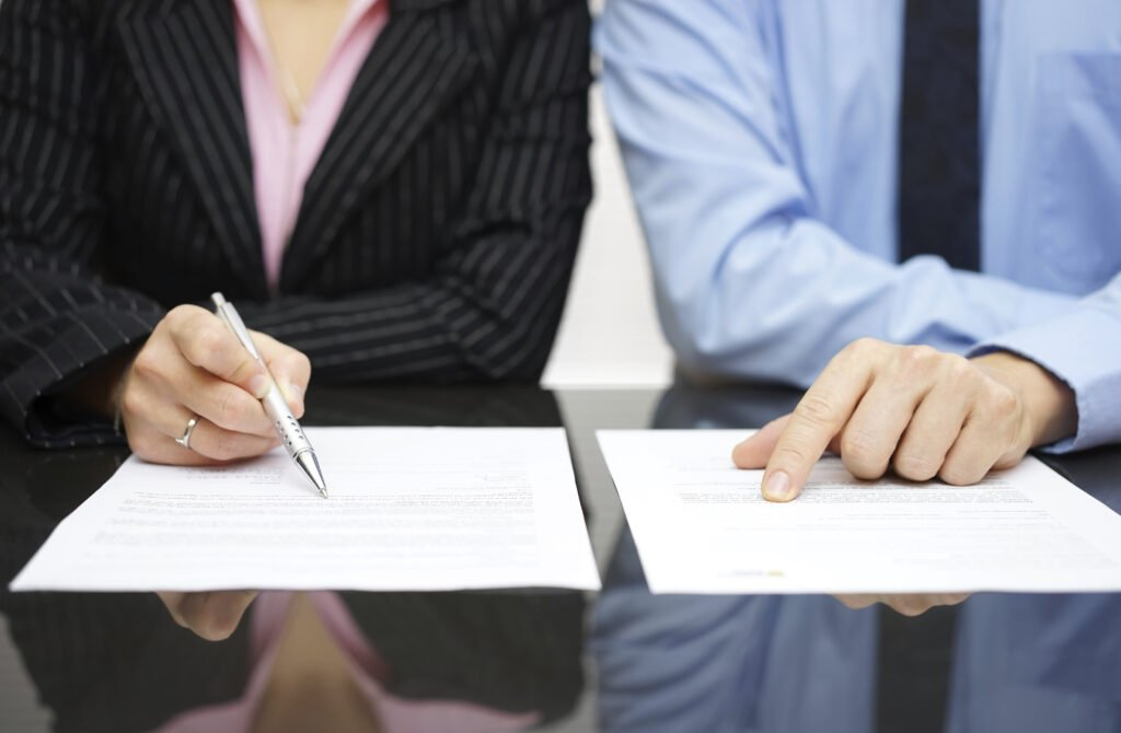businessman and businesswoman are inspecting tax contract